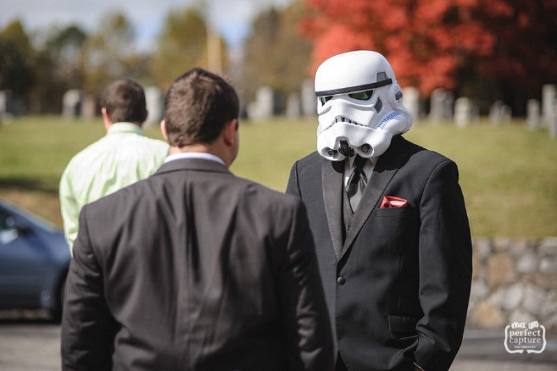 Groom wearing star wars mask