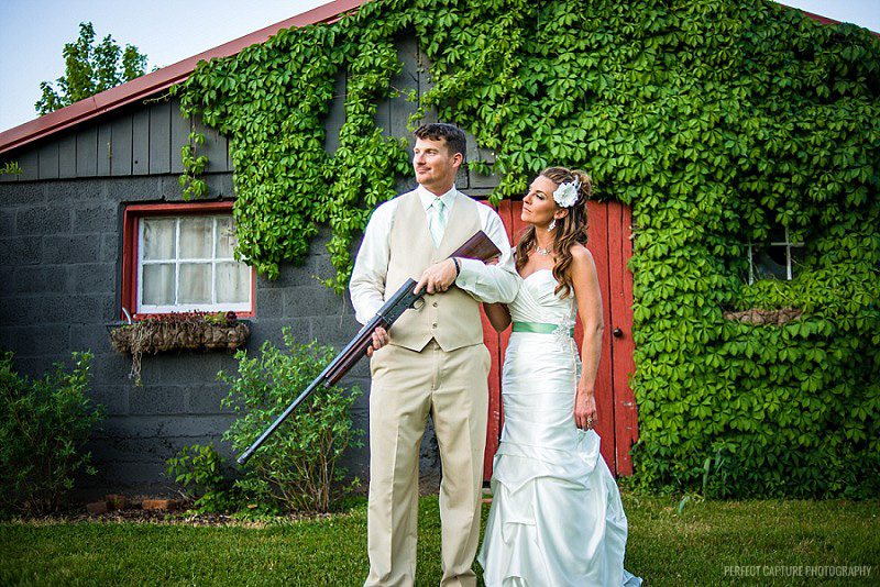 Wedding portrait with rifle