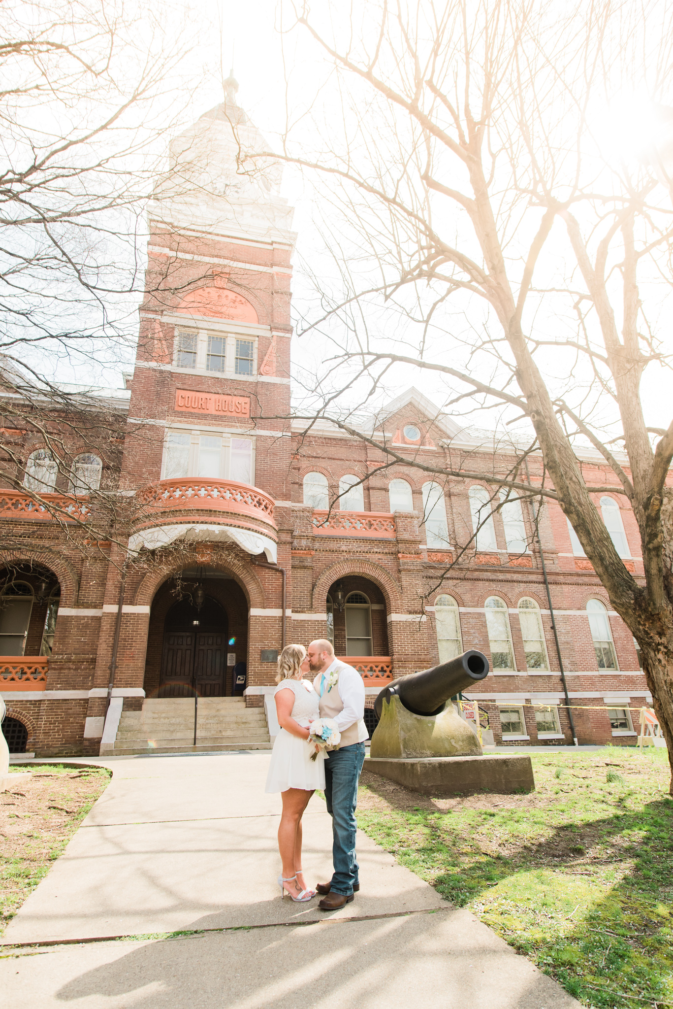 bride and groom in front of the Knoxville courthouse